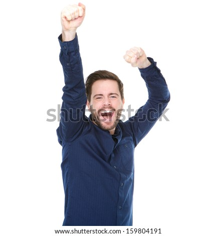 Portrait of a young man cheering and celebrating with arms raised - stock photo