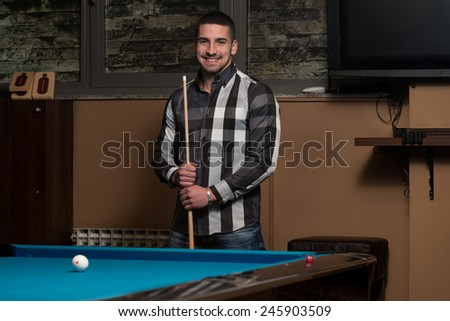 Portrait Of A Young Man Concentration On Ball - stock photo