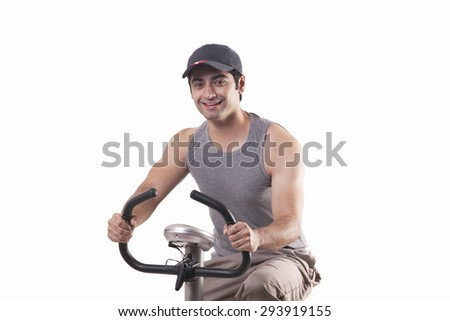 Portrait of a young man exercising over white background - stock photo