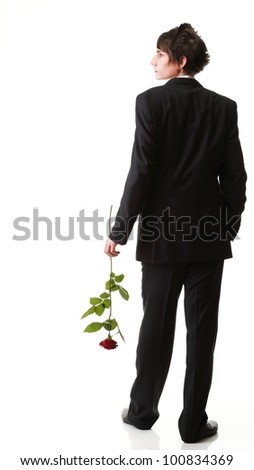 Portrait of a young man grey background. Love and rose. - stock photo