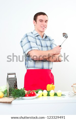 portrait of a young man, hold ladle and smile - stock photo