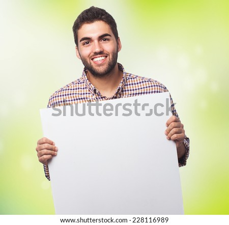 portrait of a young man holding a banner - stock photo