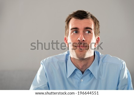 Portrait of a young man in a blue shirt - stock photo