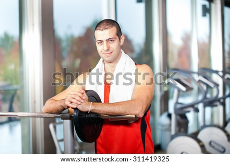 Portrait of a young man in a gym - stock photo