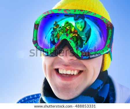 Portrait of a young man in a ski mask in ski resort