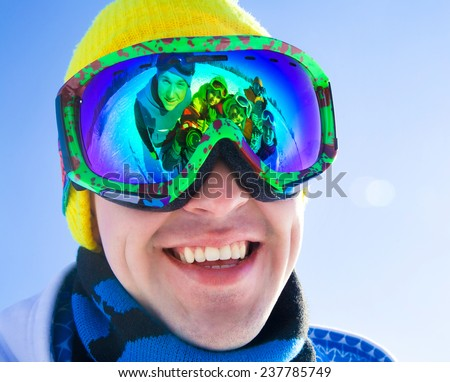 Portrait of a young man in a ski mask with reflection group of friends - stock photo