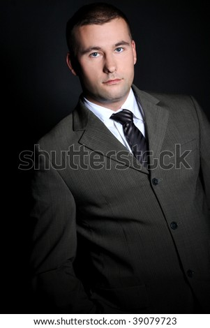 Portrait of a young man in a suit, studio shot