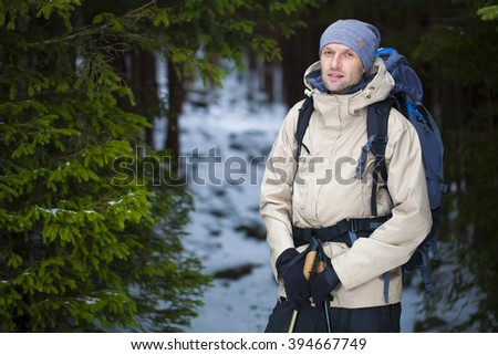 Portrait of a young man in a winter forest with a vintage filter. - stock photo