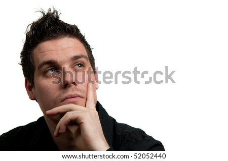 Portrait of a young man in black clothes looking up and thinking, isolated on white - stock photo