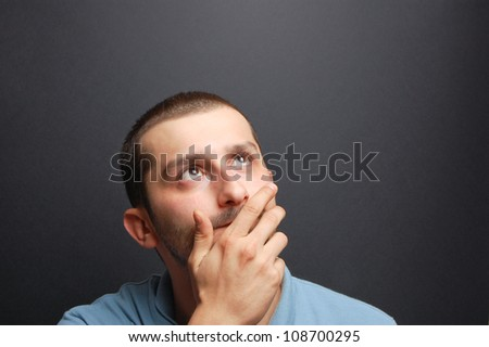 portrait of a young man in front of a chalkboard - stock photo