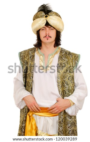 Portrait of a young man in oriental costume - stock photo