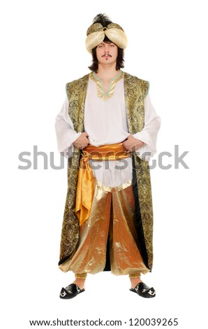Portrait of a young man in oriental costume. Isolated - stock photo