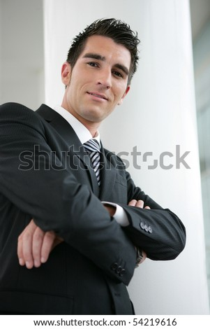 Portrait of a young man in suit - stock photo