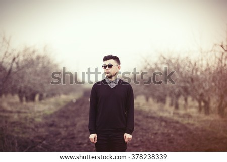 Portrait of a young man in sunglasses at outdoor