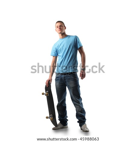 Portrait of a young man in trendy clothes holding a skateboard
