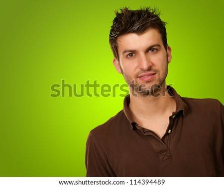 Portrait Of A Young Man Isolated On Green Background - stock photo