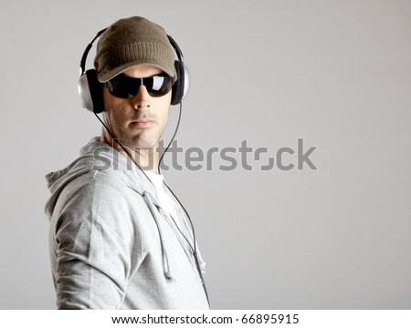 Portrait of a  young man listen music with headphones - stock photo