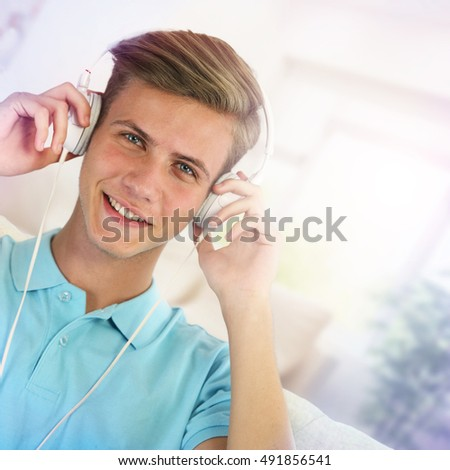 Portrait of a young man listening to music