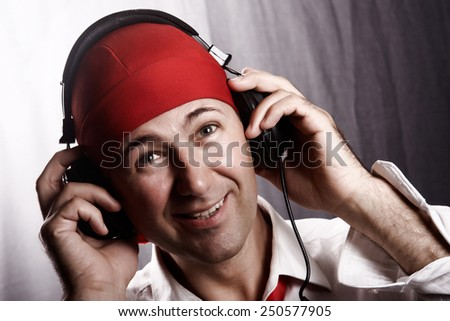 Portrait of a young man listening to music with headphones