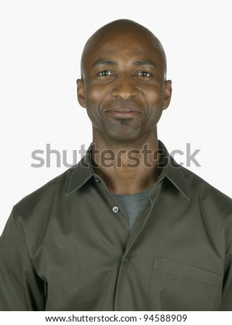Portrait of a young man looking at camera - stock photo