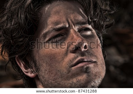 Portrait of a young man looking concerned - stock photo