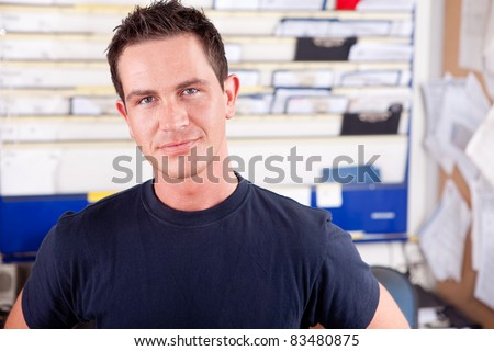 Portrait of a young man mechanic in office - stock photo