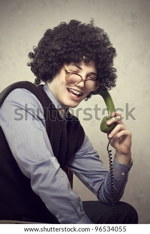 Portrait of a young man on the phone - stock photo