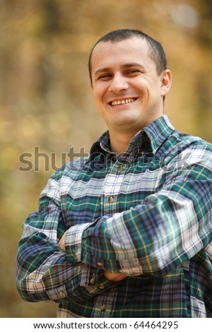 Portrait of a young man outdoor in the forest - stock photo