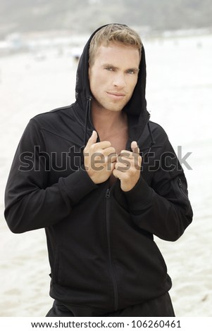 Portrait of a young man outdoors in activewear - stock photo