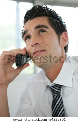 Portrait of a young man phoning