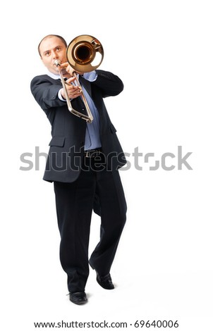 Portrait of a young man playing his trombone on white - stock photo
