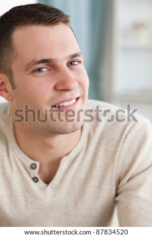 Portrait of a young man posing in his living room - stock photo