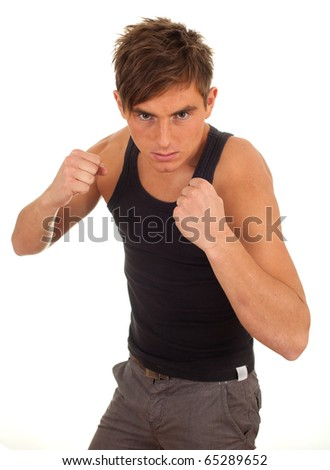 portrait of a young man ready to fight - stock photo