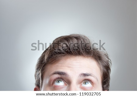 portrait of a young man���´s forehead and eyes with empty space - stock photo