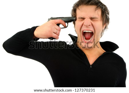 Portrait of a young man's head out to a pistol on an isolated background