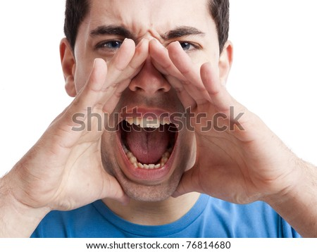 Portrait of a young man shouting loud with hands on the mouth, isolated on white background