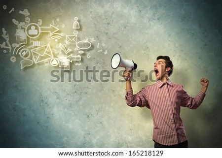 Portrait of a young man shouting using megaphone, of the horn fly, abstract symbols - stock photo