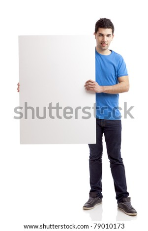 Portrait of a young man showing an empty billboard on white background