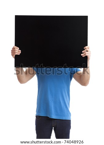 Portrait of a young man showing an empty black billboard on white background - stock photo