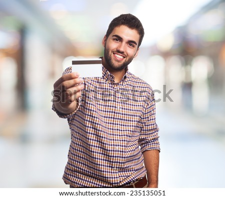 portrait of a young man showing his credit card - stock photo