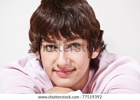 Portrait of a young man, smiling - stock photo