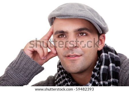Portrait of a young man smiling, in autumn/winter clothes, isolated on white. Studio shot - stock photo