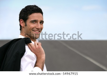 Portrait of a young man smiling in suit - stock photo