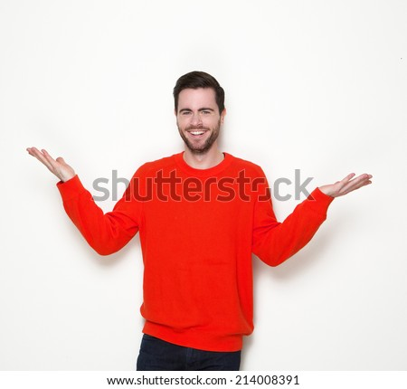 Portrait of a young man smiling with arms raised on white background - stock photo