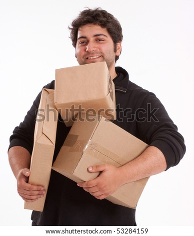 Portrait of a young man struggling with lots of parcels - stock photo