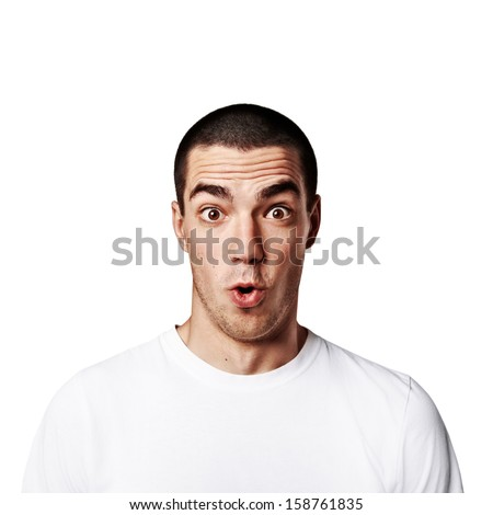 portrait of a young man surprised face expression - stock photo