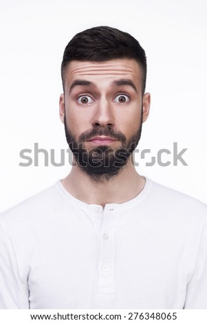 Portrait of a young man surprised face expression. Isolated on a white background. - stock photo