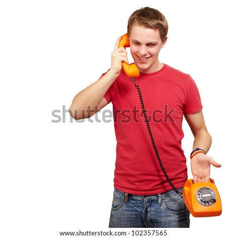 portrait of a young man talking on a vintage telephone over a white background