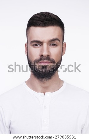 Portrait of a young man thoughtful face. Isolated on a white background. - stock photo