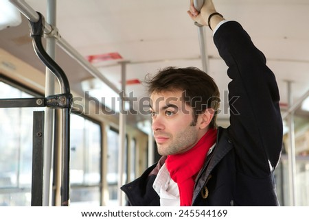 Portrait of a young man traveling alone by public transport - stock photo